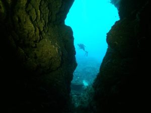 diver hovering outside a pass-through